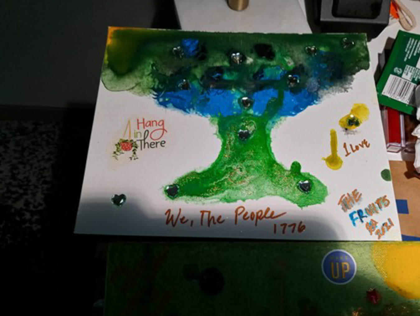 Title: The Promised Land. Water-based illustration featuring green tree.